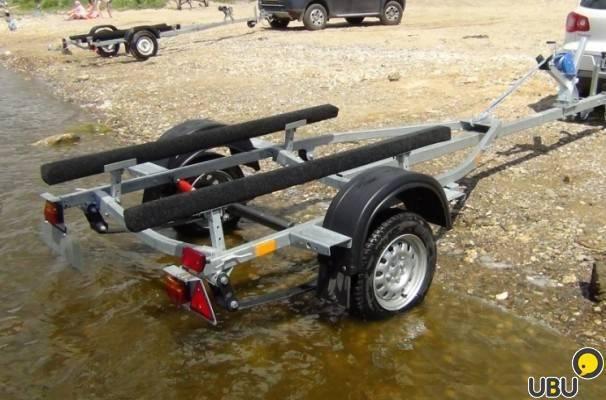 Прицепы для лодок из пвх (25 фото): лодочные прицепы для перевозки надувных резиновых конструкций с мотором. можно ли перевозить лодку на обычном автоприцепе?